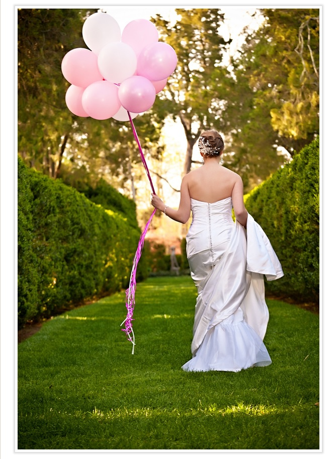 bride-strolling-with-pink-balloons