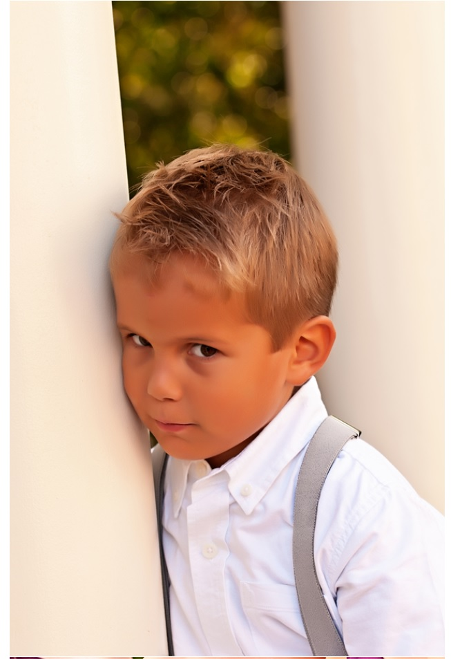 Little boy in white shirt with suspenders