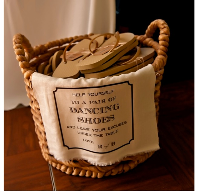 Wedding decor flip flops in basket for dancing shoes