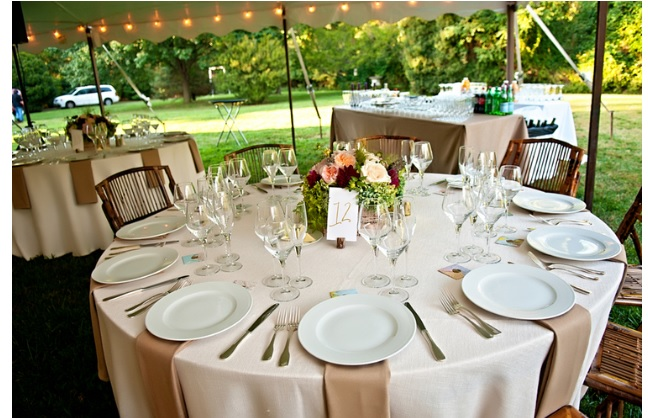 Wedding decor reception table with flowers outdoors