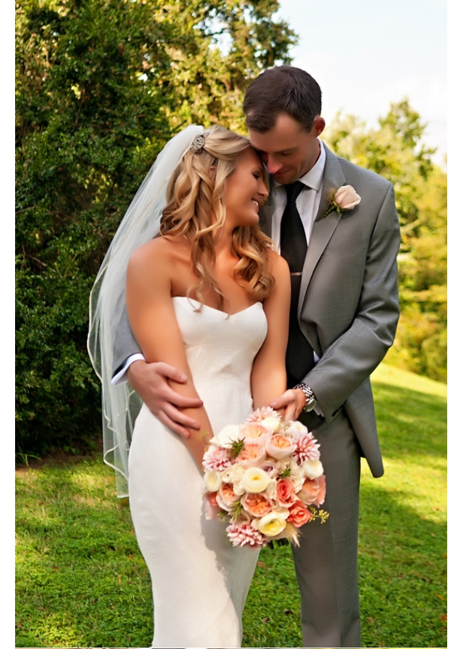 Bride and groom embrace in closeup portrait outdoors