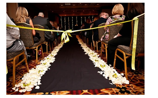 Flower petals in aisle at wedding