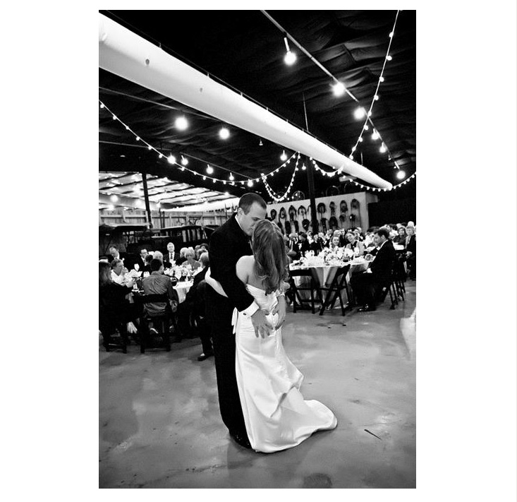 Black and white photo of bride and groom kiss
