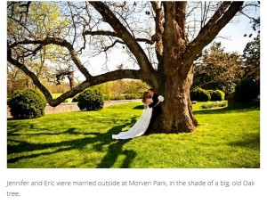 Bride and groom embrace under oak tree