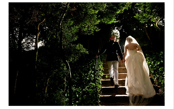 Rear view of bride and groom in uniform climbing steps at Oatlands