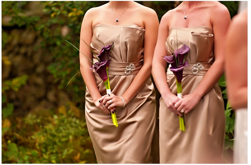 Bridal party dresses and bouquets
