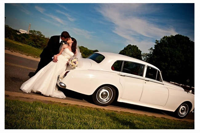 Bride and groom with white limousine.