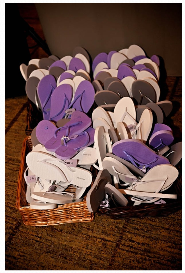 Purple and white flip flops